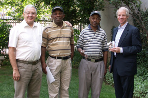 Mervyn Wilson and Charles Gould of the ICA with members of Tshepanang ex-combatants co-operative in Sotuh Africa.